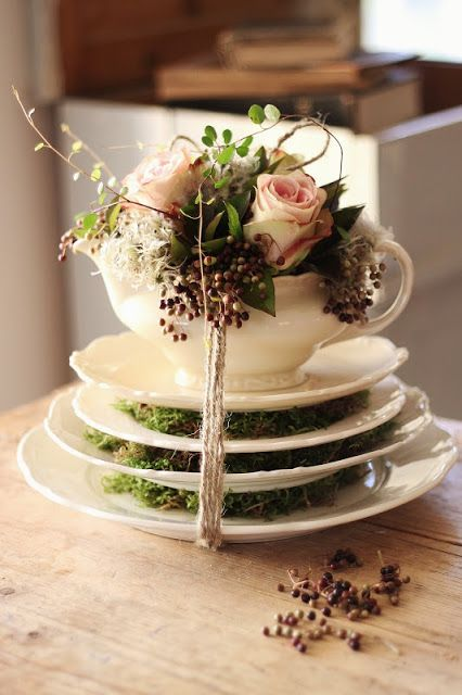 This is quite lovely using different color cups and saucers, a bit more moss....beautiful statement for a particular wedding