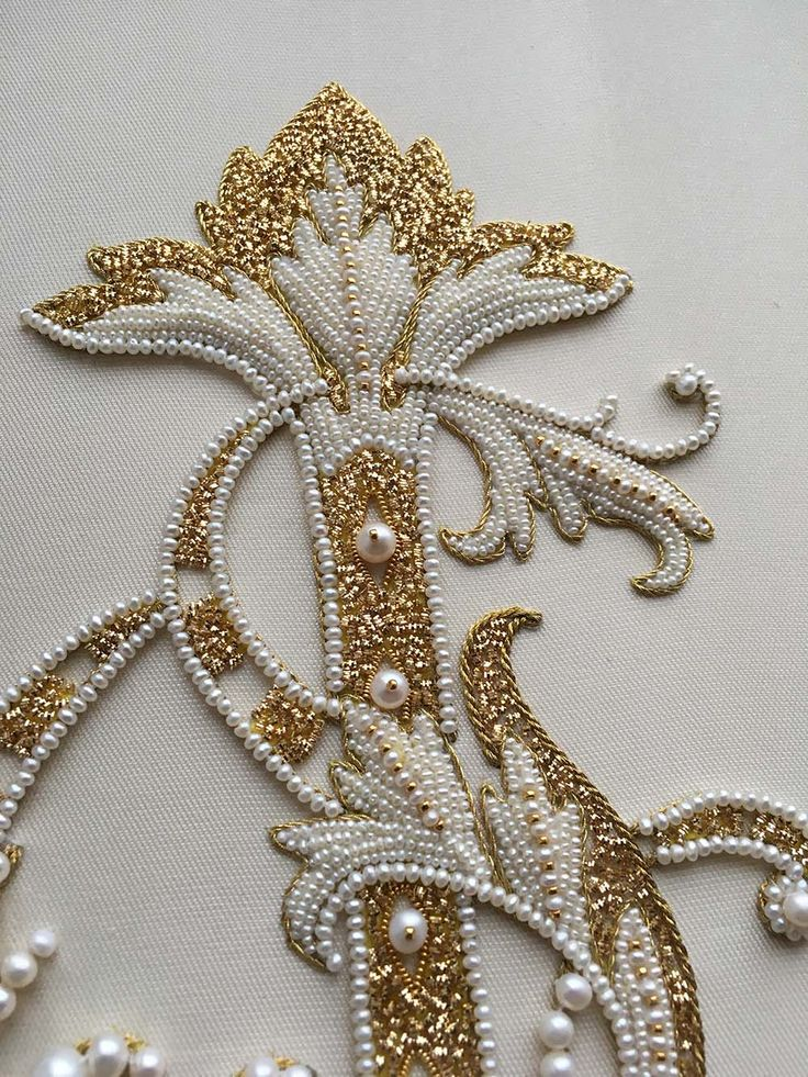 Detail of Ornate letter. Pearl embroidery done by Larissa Borodich