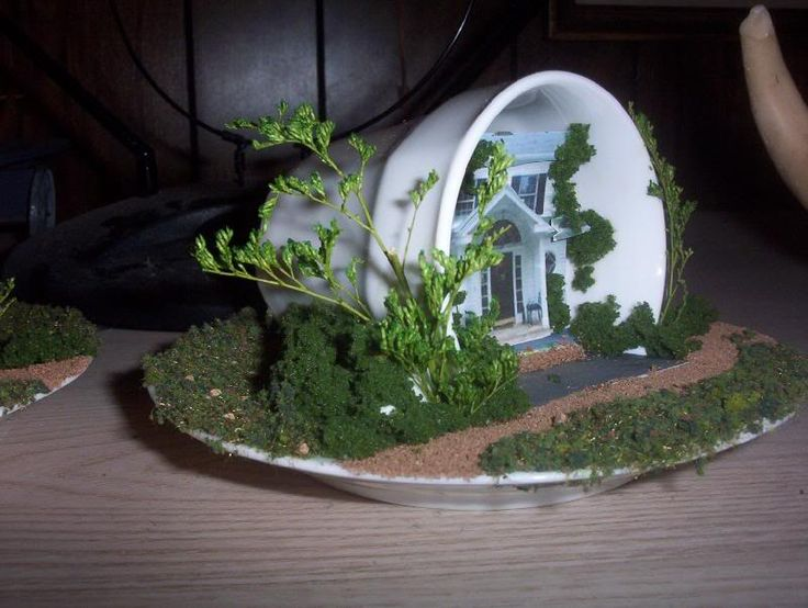 Bury a pot half way in the soil fairy house in a tiny garden. Clay color ,add a door, etc.