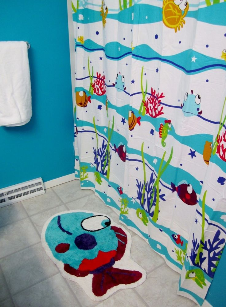 Cute Kids Bathroom Design with Sea Themed Shower Curtain and Fish Shaped Mat also Blue Wall and Marble Tiles