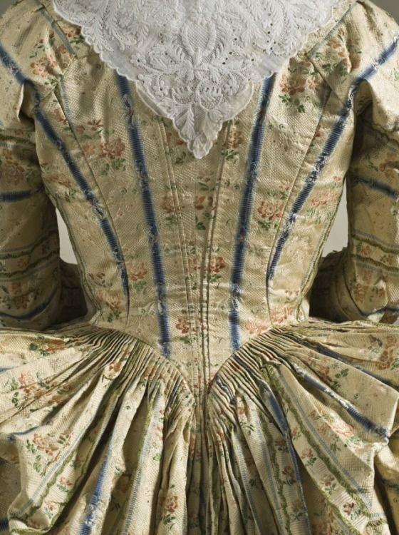 Woman's Robe à la Polonaise (Close-bodied Gown) France, circa 1775 Costumes; principal attire (entire body) Silk plain weave with supplementary warp- and weft-float patterning Center back length: 54 1/4 in. (137.795 cm)