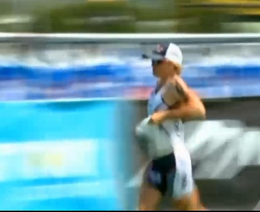 Mary Beth Ellis starts the Kona Ironman run in second place.