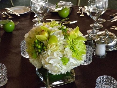 Green and white wedding centerpiece decor