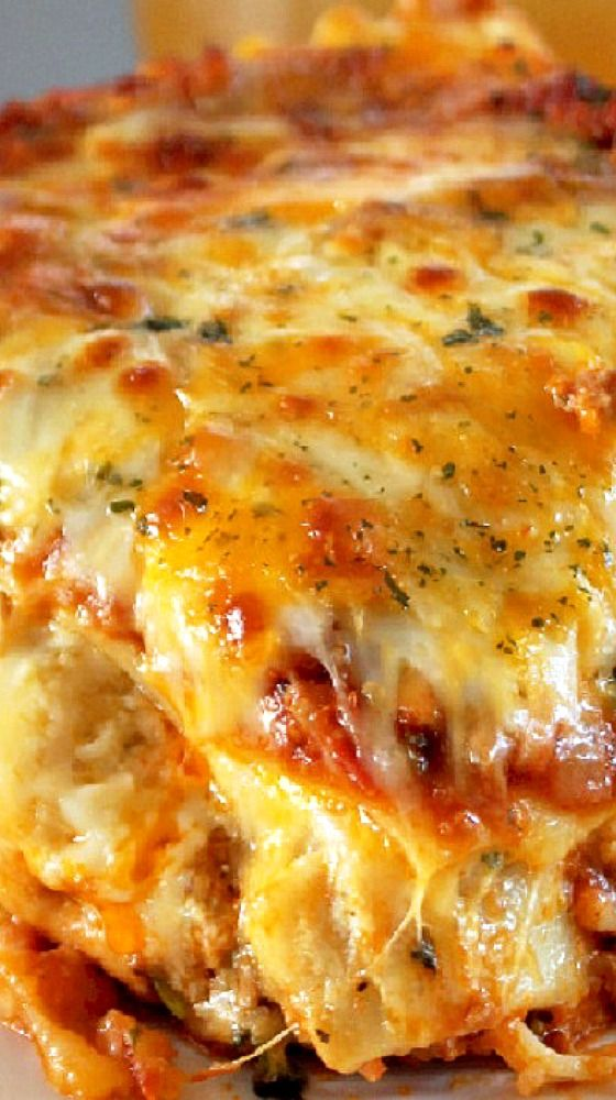 Cajun Lasagna — I made up a cheesy mixture of eggs, ricotta cheese, sharp, jack, mozzarella, & parmigiano reggiano cheeses. Yes, we're loading this lasagna with 5 cheeses! I've made lasagna with one cheese before & it's just not the same. The mixture of cheeses gives the lasagna a richer depth of flavor - Creole Contessa!