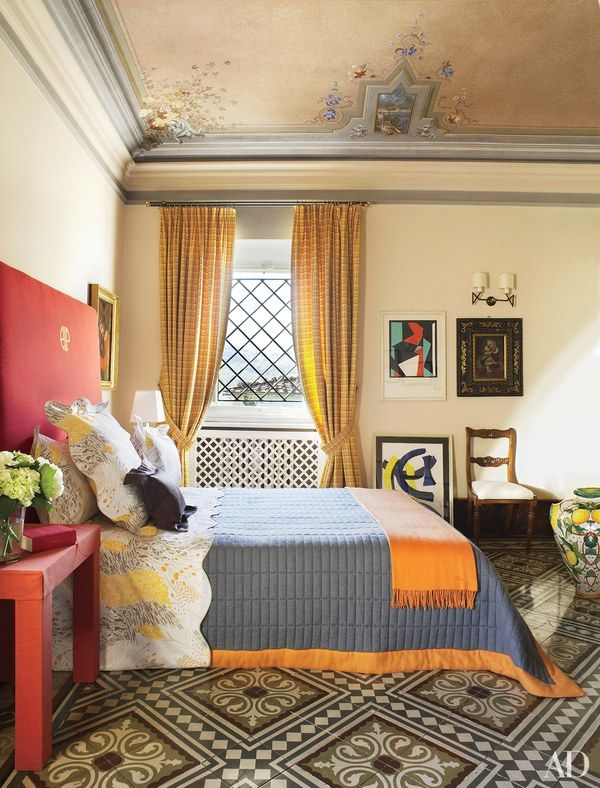 The monogrammed headboard and the table in the guest bedroom of Dede Pratesi's Tuscan villa are both covered in canvas   archdigest.com