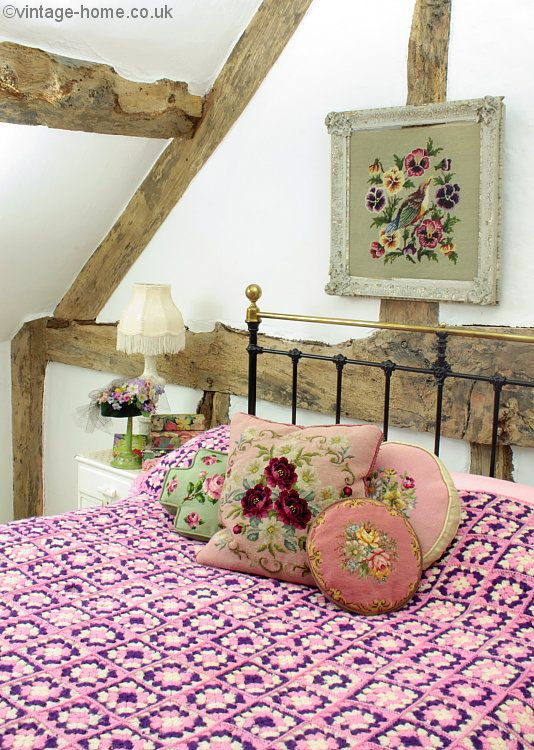 An assortment of Pretty Embroidered Cushions and a Lavender and Lilac Crochet Throw dress the Cottage Bedroom: www.vintage-home.co.uk