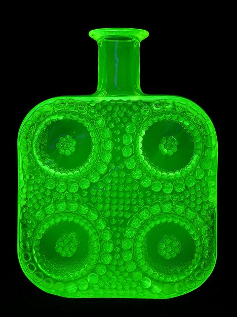 "Riihimaki ""Grapponia"" vaseline glass bottle designed by Nanny Still under UV light"