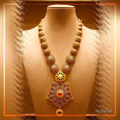 When you plan to dazzle the world with your inner shine you can never go wrong with this beautifully carved #GoldNecklace. A gorgeous traditional pattern crowned perfectly with diamonds, emeralds and rubies. #SuunarJewelsIndia