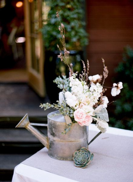 love the watering can, the succulent, the colors...
