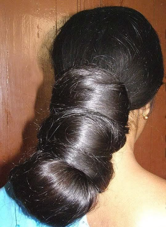 long black hair in magnificent bun by Indian lady. Beauty is at every age, and we can embrace God's gifts. A wife's long hair is just naturally beautiful, a glory to her and a joy to her partner/husband. Quit trying the artificial route and trust in how you were made.