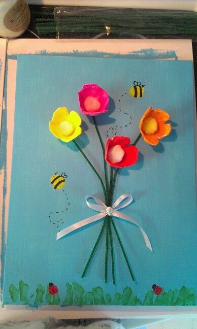 Mother's day craft with children's finger prints as bees and lady bugs. Also used partial hand prints for the grass. Egg cartons for the flowers with pipe cleaner stems. All mpunted on canvas (pre painted) with hot glue. Kids loved making it!