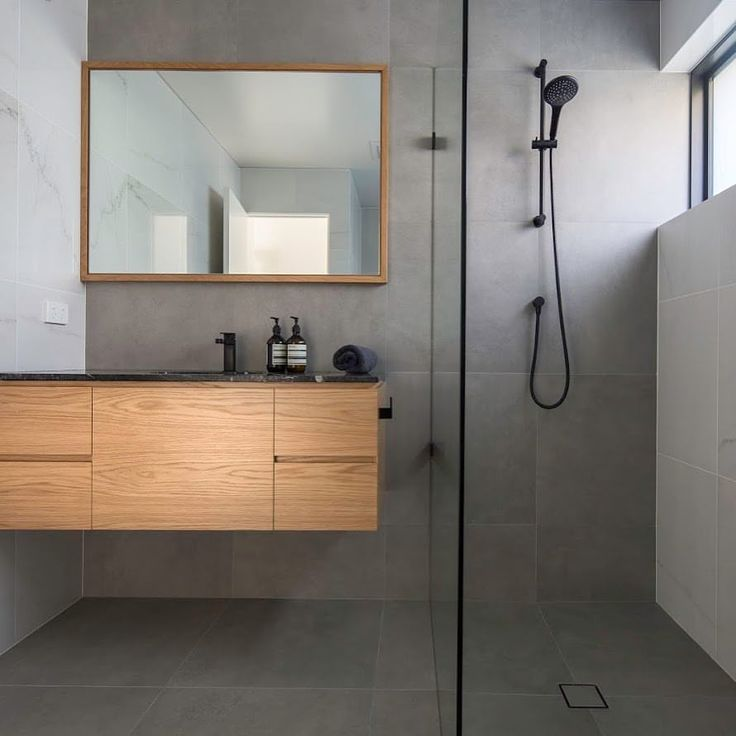 D3 projects captures a bathroom utilising Rivoland's porcelain tile for floor and wall. The simplistic colour palette creates a subdued, intimate space.