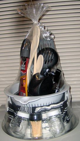 """THE """"MAN"""" Towel Cake! I am going to do this with grilling items, Hot sauces, & BBQ sauces as a birthday gift! I will use a funny apron instead of one of the towels, and stick a Giant Eagle gift card in there to buy grilling meat! I think he will love it! A thoughtful, useful, cue gift idea for guys!  :)"""