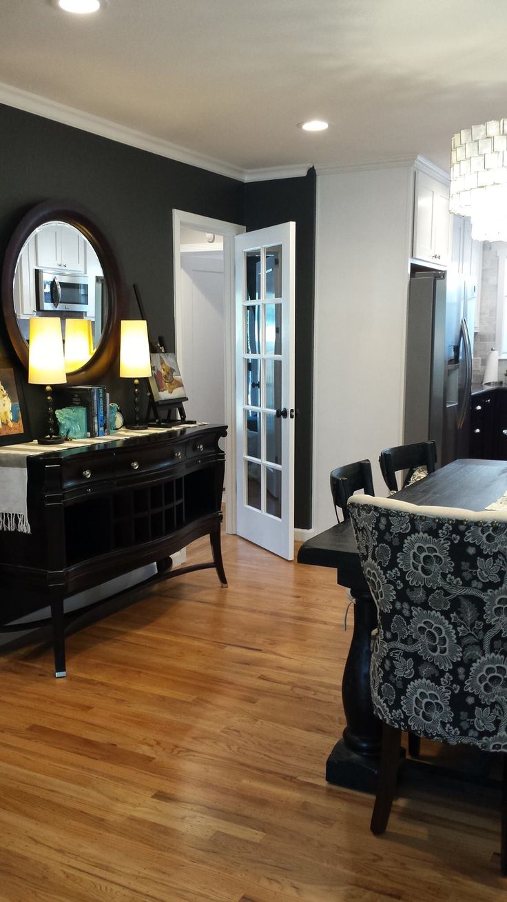 Charcoal black walls are Peppery by Behr, dining furniture ...