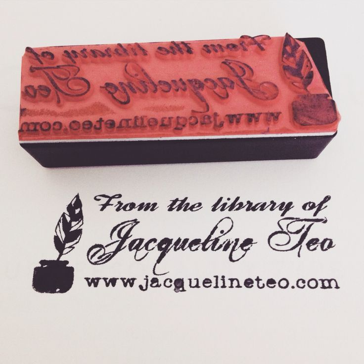 Library or book stamp with quill and ink