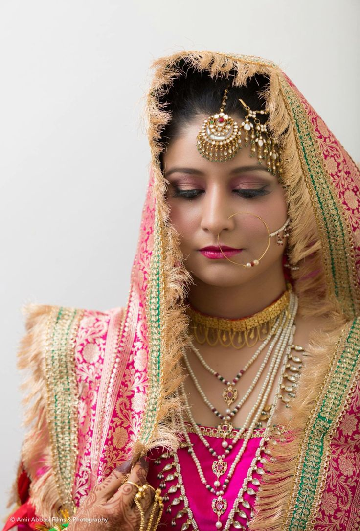 Muslim traditional Indian bride.. Traditional jewelry and gharara.. Natural makeup in pink shades to match