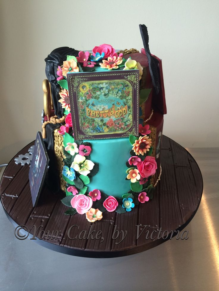 Panic At The Disco P!ATD 'Pretty odd' incorporated onto this section of the cake. Using handmade edible flowers and leaves  they created a 3d version of the album. Also an edible print was used for the album cover.