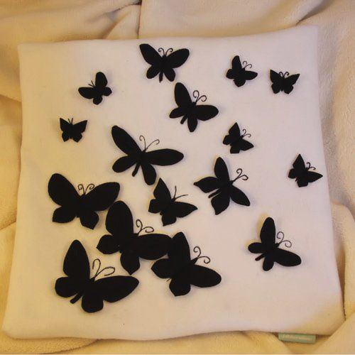 Cushion Cover - Black felt butterflies on white felt background.