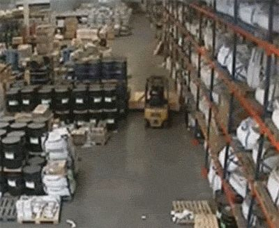 The decision to drive this forklift through a tight space in the warehouse.