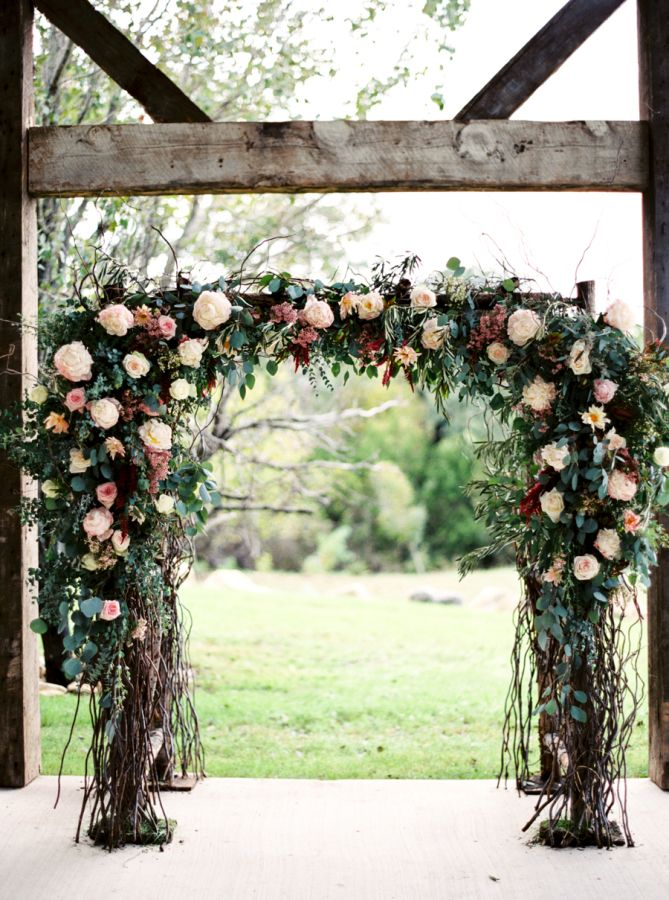 Rustic + romantic floral ceremony arbor: http://www.stylemepretty.com/texas-weddings/dripping-springs/2016/03/28/this-wedding-takes-southern-chic-to-an-entirely-new-level/ | Photography: Jenna McElroy - http://jennamcelroy.com/