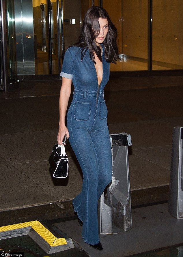 Bra-vo! Bella Hadid went braless in a plunging denim jumpsuit as she headed a fitting her upcoming Victoria's Secret Fashion Show in New York City on Sunday