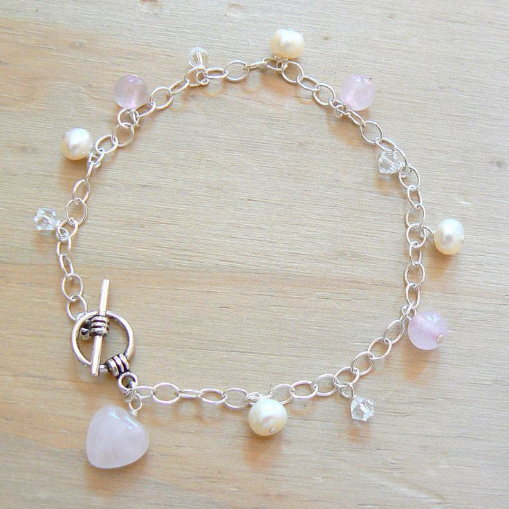 rose quartz and pearls charm bracelet by clutch and clasp | notonthehighstreet.com £45.00
