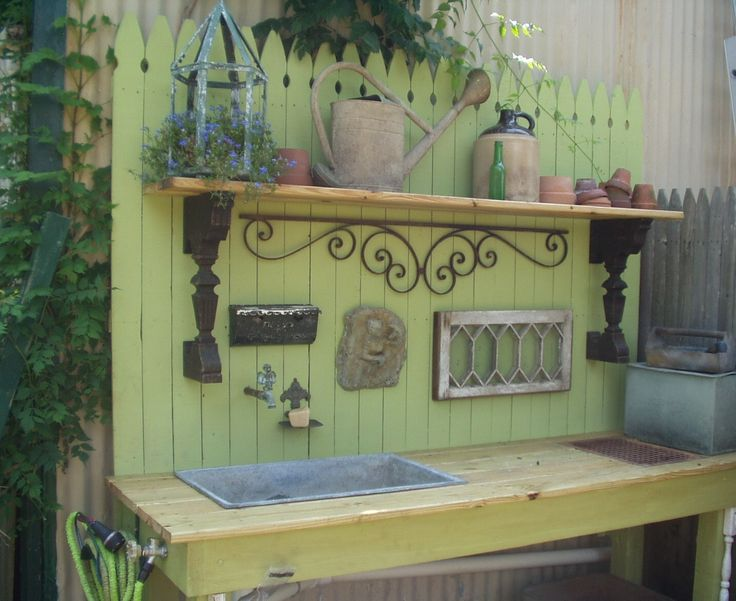 My potting bench hubby just built me with old sink I picked up on the side of the road......running water.  Angel faucet and window, three bucks at a yard sale!  Old floor grate to brush dirt into bin underneath!  Old milk box picked up on trash day holds miracle grow.  Pieces from an old piano are the shelf brackets.