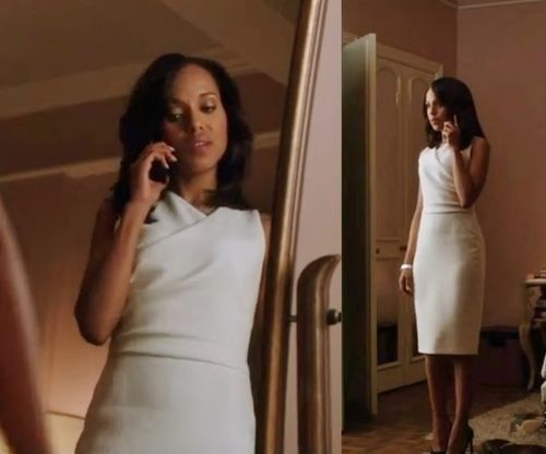 Liv in a Ralph Lauren white form-fitting sheath dress with a faux wrap neckline, fall 2012. Worn in 'Snake in the garden'