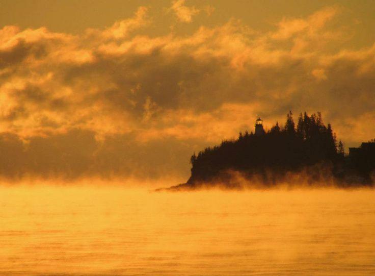 Owls Head Lighthouse, Maine -  Sunrise sets the arctic sea smoke aglow on January 3, 2013.   (Photo by Bob Trapani, Jr.)