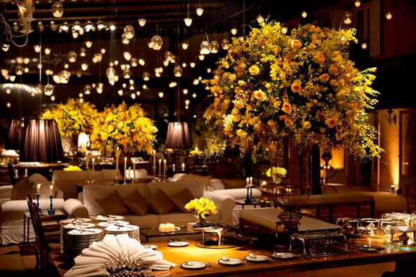 Swoon! Classy indoor reception complete with yellow accents and hanging lanterns.