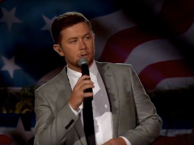 """Scotty McCreery delivered a powerful performance of """"The Dash"""" with the National Symphony Orchestra as part of the National Memorial Day Concert on PBS on Sunday, May 28.  """"The Dash,"""" which was penned by Kyle Jacobs and Preston Brust, is featured on Scotty's 2013 sophomore studio album, See You T"""
