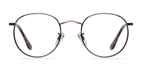 These golden brown eyeglasses are a dream. This sophisticated metal frame comes in a glossy brown finish with perfectly round shaped lenses. Tortoiseshell acetate arm tips, golden nose bridge and temples add a touch of class to this already refined look.  @EyeBuyDirect
