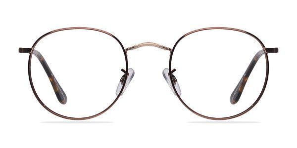 Vous allez rêver tout éveillé avec ces lunettes brunes et dorées. Cette monture sophistiquée aux formes rondes est en métal brun brillant. Ses branches en acétate écaille et son pont nasal en métal doré complètent ce style déjà unique. @EyeBuyDirect