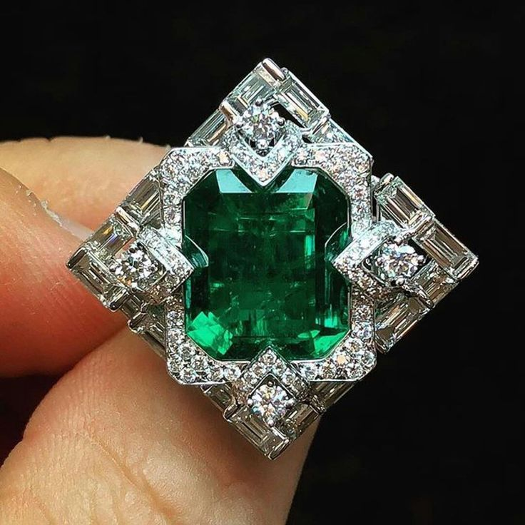 """It's part of pieces from our """"Shanghai/Shanghai"""" Collection. The strong Art Deco motif became much more sophisticated in this particular piece ! -8.08 carat Chivor emerald ring."""