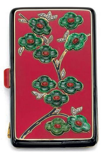 AN ART DECO ENAMEL, NEPHRITE, CORNELIAN AND DIAMOND VANITY CASE, BY VAN CLEEF & ARPELS. The red and black enamel rectangular case applied with carved nephrite, cornelian, diamond and black enamel oriental foliate motifs, to the cabochon cornelian push-piece, opening to reveal a mirror, a powder compartment and a lipstick holder. 1920s. With French assay mark for gold. Signed Van Cleef & Arpels. #VanCleef #Arpels #ArtDeco #VanityCase