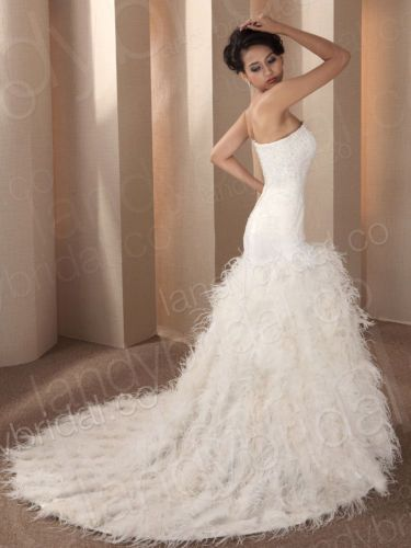 17 best images about someday wedding idea 39 s on pinterest for Mermaid wedding dresses with feather bottom