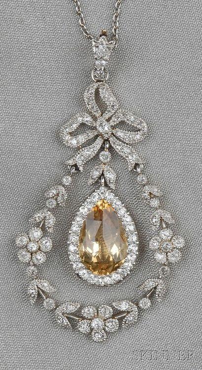 Edwardian Bow Topped Topaz and Diamond Pendant.