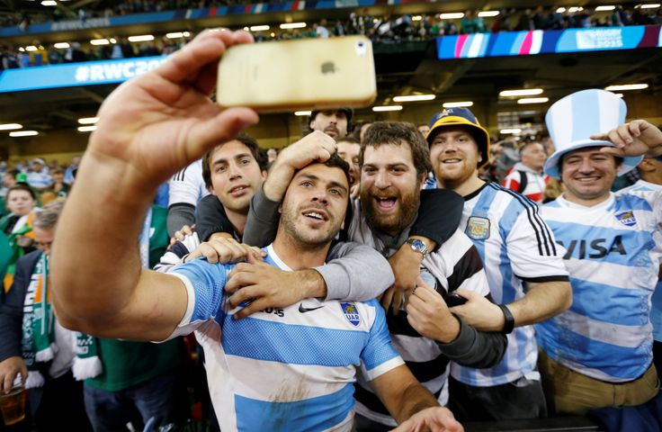 "Argentina's ""Los Pumas"" celebrating with fans after winning to Ireland in the quarter finals of the Rugby World Cup."