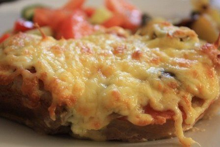 The meat in foil with mushrooms and tomatoes.