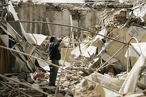 Chile Earthquake: A man stands amidst the rubble after earthquake in Santiago, Chile