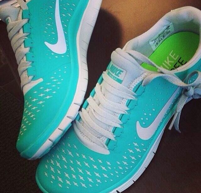 Turquoise Nike trainers.