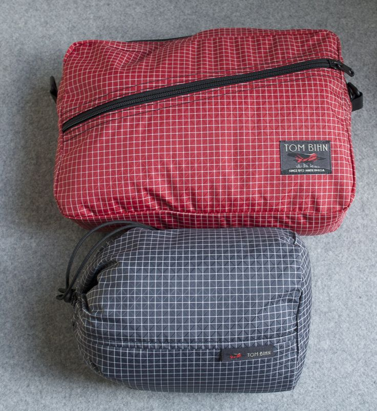 A full cool weather capsule wardrobe for girls all packed up in a Tom Bihn packing cube shoulder bad and a Travel Stuff Sack.