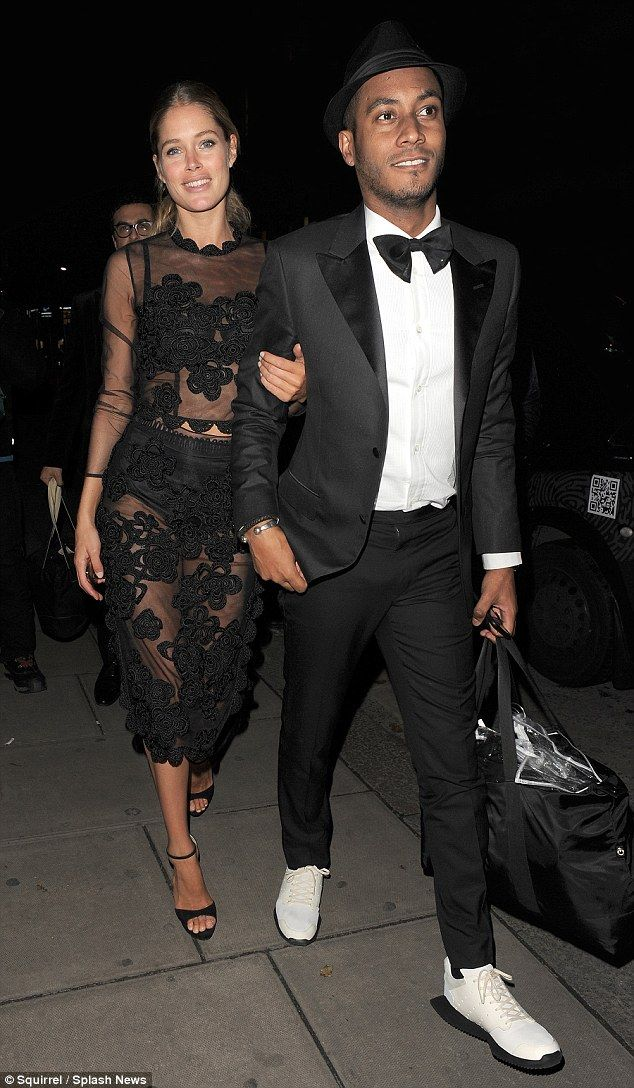 Here they come: Dutch model Doutzen Kroes returned to her London hotel with dapper husband Sunnery James following the Victoria's Secret runway show at Earl's Court on Tuesday evening