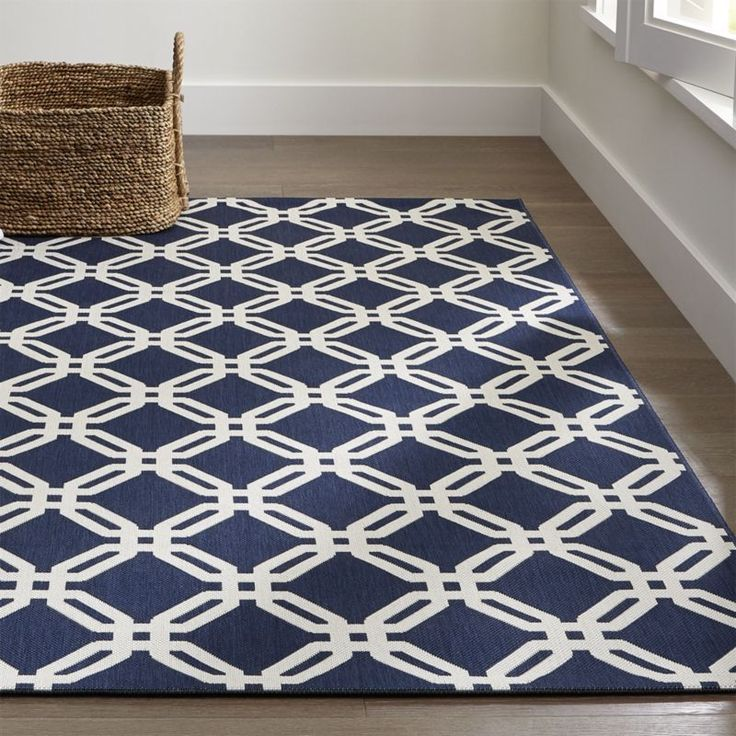 Shop Arlo Blue Outdoor Rug.  Decorative iron gates spied in an old house in Paris inspired designer Chris Mestdagh to create this eye-catching blue outdoor rug.