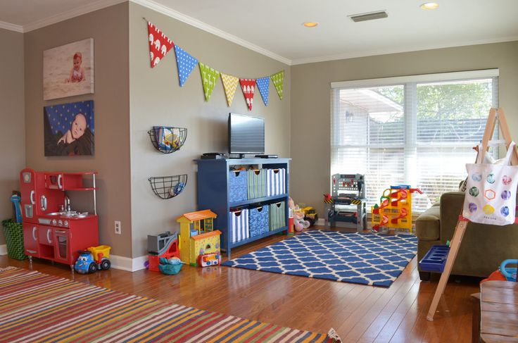 kids playroom ideas Traditional Kids Colour Schemes Dallas blue bookcase bright children colors geometric rug gray walls kids kids play kitchen penant pennant play room primary color scheme rumpus shelves gray walls