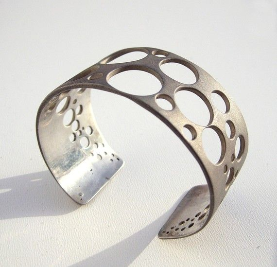Sterling Silver Cuff Bracelet Sandblasted Geometric Jewelry Ooak - Bubbles Sometimes silence is more meaningful than words, just as empty spaces are more important than the ones filled. This was the idea that drove me to create the bubbles, a sparkling collection that plays with transparence and light like soap bubbles do. The bubbles collection includes rings, a bracelet, pendant-rings and earrings. The bracelet is in streling silver, with a sophisticated sandblasted finish which gives...