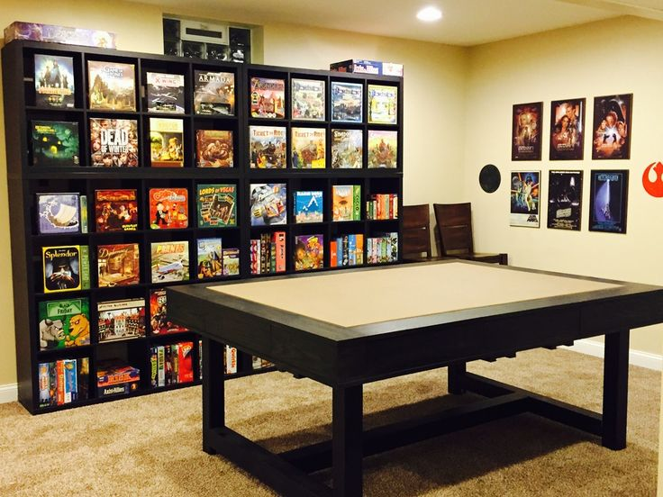 Large table and bookcase with games. Would probably go with white for the shelving unit though and table edges lighter too.