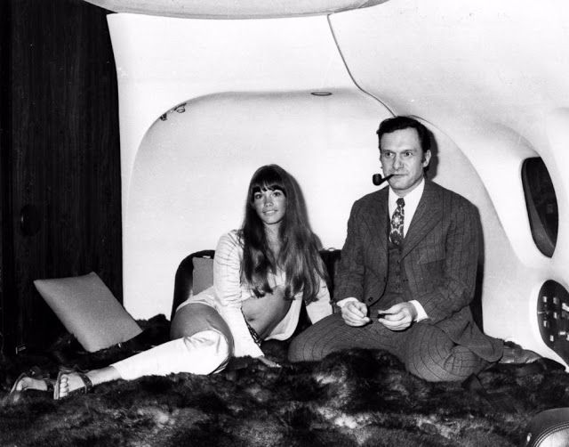 The president of Playboy Enterprises, Hugh Hefner, with girlfriend, Barbi Benton in his luxury DC-9 aircraft 'The Big Bunny' at Heathrow. vintage everyday: 14 Remarkable Black and White Photographs Capture Air Travel in Its Glory From Between the 1930s and 1970s