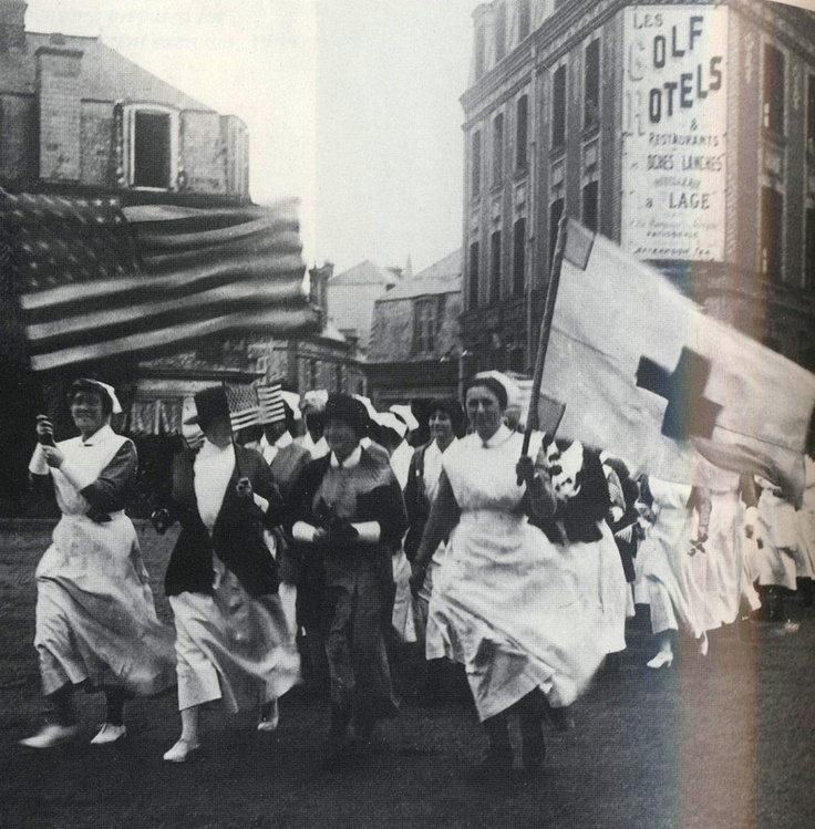 Nurses of Base Hospital No. 2 in a parade for Anna Maxwell, founder of the Columbia School of Nursing. The Red Cross flag is from Maxwell's unit in the Spanish–American War.