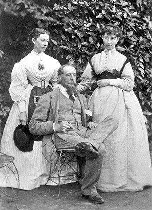 Charles Dickens with daughters Katey and Mary in the garden at Gad's Hill Place in Higham, Kent - home of Dickens' family from 1858 until his death in one of the rooms in 1870.